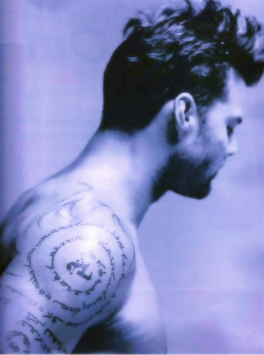 his Assyrian Aramaic Lord's Prayer tattoo in a promotional photo.